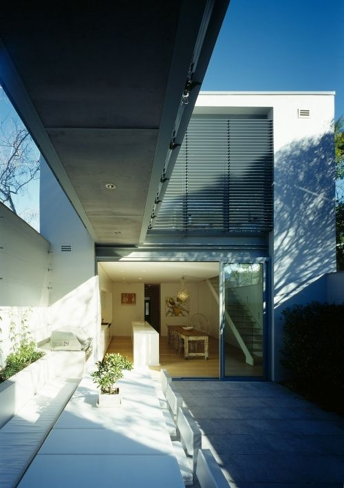 This renovation of Fink House is designed by Ian Moore Architects and located in Sydney, Australia. The home's previous condition was poor, and the architects had to concoct several techniques to conceal the building's various unsightly elements.