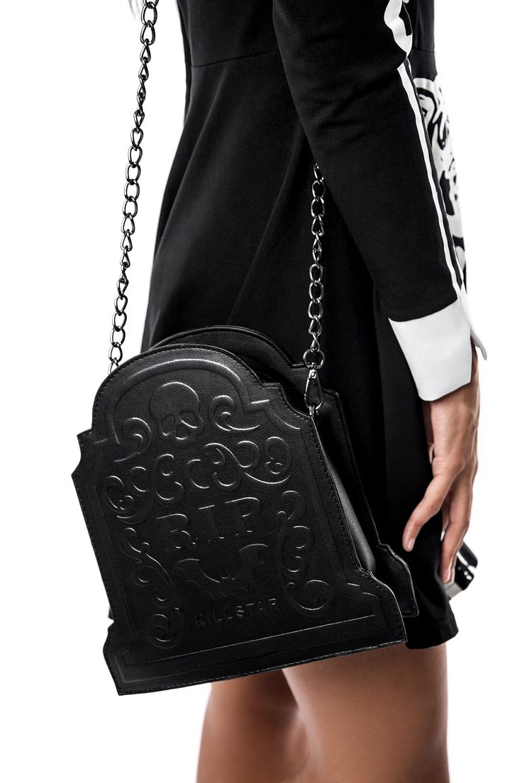 Sarah Sins RIP Handbag. Fashion forward gothic tomb-bag with large embossed 'RIP' detailed front - with darkened lightweight chain; keeping it classy for all the vamp & ghouls alike. The unique gravestone shape makes it a perfect statement handbag to compliment your killer lookz.