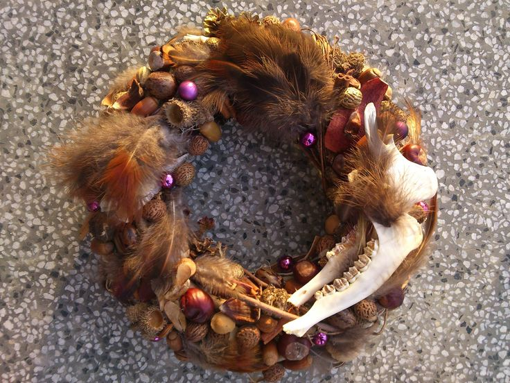 Wild Christmas Wreath. No animals got killed to create this wreath. All found in the nature! Chestnuts, acorns, feathers and bones. Merry Christmas