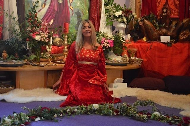 Priestess of Avalon, Dawn Kinsella, preparing a ceremonial circle of flowers for a handfasting in the Glastonbury Goddess Temple