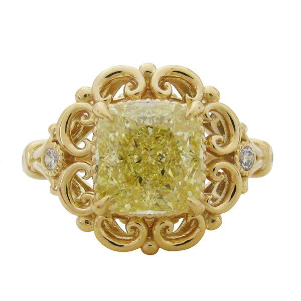 THE STEPHANIE RING  This gorgeous yellow cushion cut diamond is in cased with lovely scrolls inspired from the Baroque Era