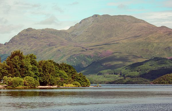 "The Scottish Mountain ""Ben Lomond"" from the shoreline of the village of Luss, Argyll & Bute. Ben Lomond is one of the ""Monroe"" mountains, meaning it is over 3000 ft high."