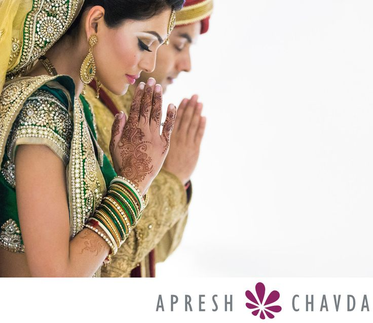 Asian Wedding Photographers London: Indian, Hindu Wedding Photography, Sikh Wedding Photography - oshwal-centre-wedding-photos-by-apresh-chavda: Shooting at the Oshwal Centre in Potters Bar can be a spiritual experience. The grounds and temple area are serene and peaceful and brings home the religious aspect of a Hindu or Jain wedding celebration. This image was taken as the couple were being blessed and reflects the calmness of the location. The negative space in the image enhances the…