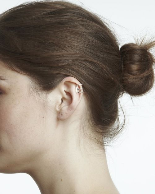 Maya Magal Silver Outline Earcuff: This simple Maya Magal ear cuff can sit anywhere on the ear. It's versatile and easily adjustable by pulling it apart or pushing the edges together. For the best look we recommended positioning on your ear as shown in picture.