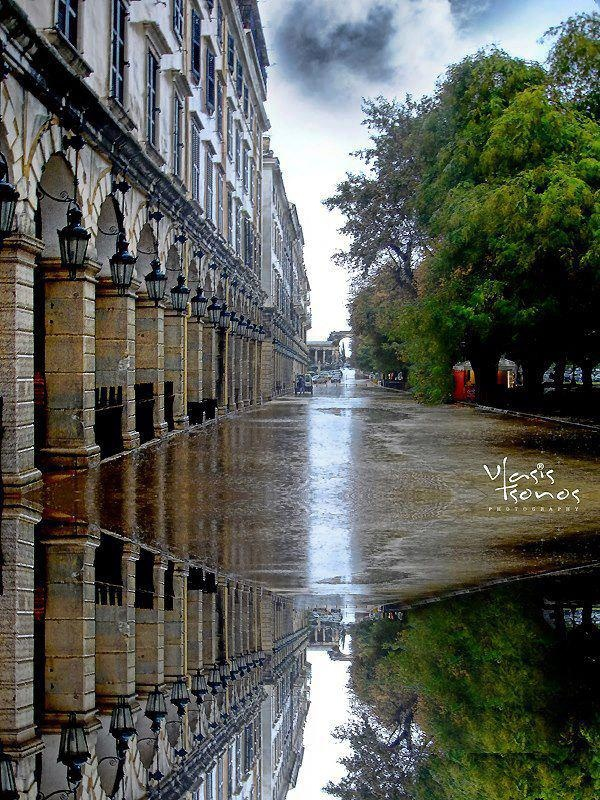 Ionian Sea, Corfu island, Greece Reflections at Liston Sq, one rainy day in the Town of Corfu - By Vlassis Tsonos
