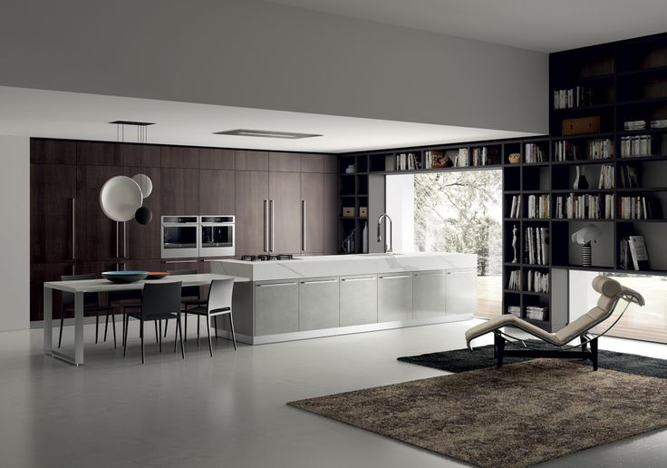 The central island, which stands out for its ultra thick (18.5 cm) Extra White porcelain stoneware worktop, stretches into a table-height worktop made of the same material, teamed with Mya chairs all round. The surfaces perfectly integrate with one another, and lie at the heart of the domestic activities and of the living area.
