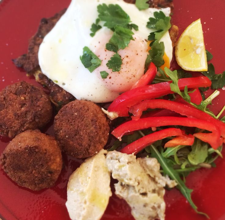 Middle eastern lunch of falafels, cauli fritters, hommus, babaganoush, capsicum, herbs and egg