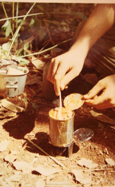 cooking c-ration dinner on modified stove