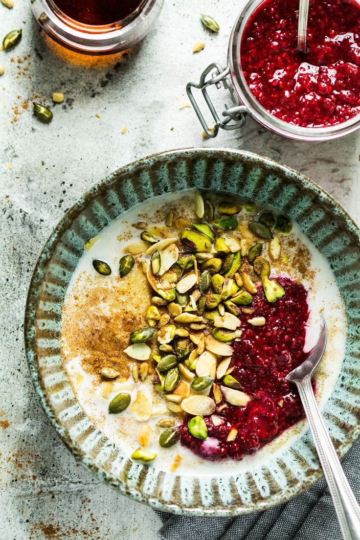 Amaranth porridge topped with nuts and seeds and a quick raspberry chia jam makes a delicious naturally gluten-free and vegan breakfast, full of plant-based protein and boasting a complete set of amino acids needed by our bodies.