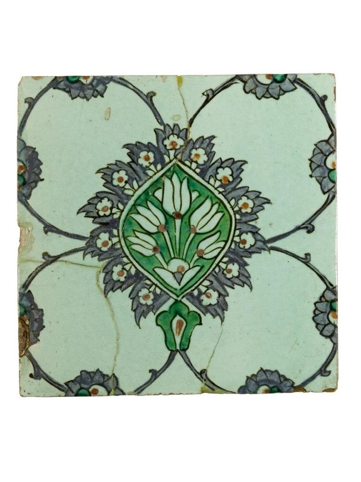 Tile of glazed earthenware, with a foliated design in colours on a pale green ground: Turkey