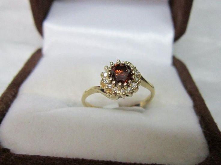 Upcycled 1940's Red Diamond Ring in a 1960's Round Diamond Setting. from odditiesandantiquites on Ruby Lane
