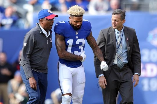 Giants vs. Ravens:     October 16, 2016  -  27-23, Giants  -      Oct 16, 2016; East Rutherford, NJ, USA; New York Giants wide receiver Odell Beckham Jr. (13) is helped off the field after sustaining an apparent injury during the second quarter against the Baltimore Ravens at MetLife Stadium. Mandatory Credit: Brad Penner-USA TODAY Sports