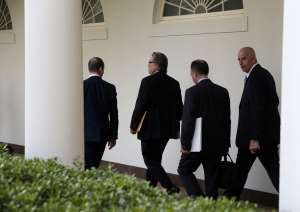 FILE: Senior White House Advisor Stephen Miller (L), White House Chief Strategist Stephen Bannon (2nd L), White House Chief of Staff Reince Priebus (2nd R) and Keith Schiller, deputy assistant to the president and director of Oval Office operations, walk down the Colonnade of the White House in Washington, U.S., April 18, 2017.