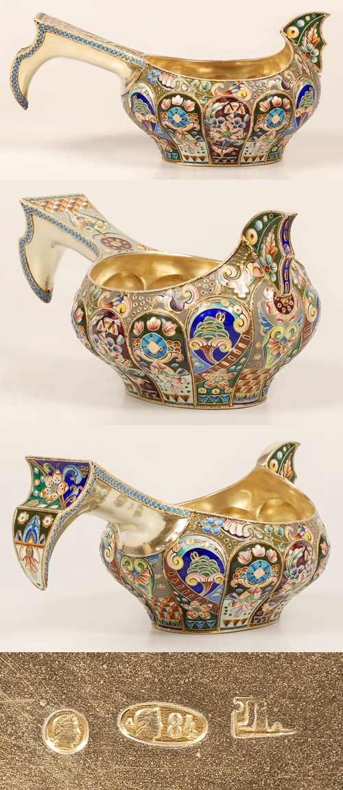 A Russian silver gilt and cloisonne enamel kovsh, Moscow, circa 1908-1917. of traditional form with raised prow and lobed body, the kovsh completely worked in vibrant multi-color stylized scroll and floral motifs with geometric accents, the hokk-shape handle banded by a row of turquoise enamel beads similarly decorated.