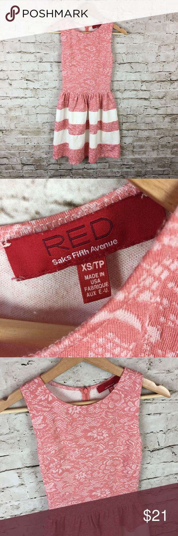 "Women's RED Saks Fifth Avenue Dress size XS Women's RED Saks Fifth Avenue Dress size XS.  Nice Sleeveless Dress made of Rayon with nice Stretch.  Blush Lace Bodice with Blush and White Striped bottom.  In gently used condition. Please see pictures for details.  Armpit to Armpit - 12.5"" Length - 32""  Thank you for shopping with us, we appreciate your business.  *All items are measured laying flat, please be sure to check sizing before purchasing. All brands do fit differently and all sales…"