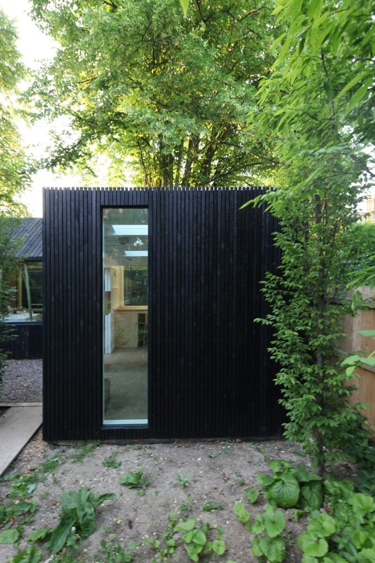 rodic davidson garden workshop | gardenista Siding is black stained plywood and windows are Velfac panels