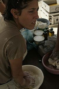 Indian Frybread - A member of the Creek Nation and US Military makes frybread during a pow-wow in Iraq while deployed for the Iraq War -Wikipedia