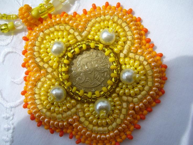 Napsárga medál