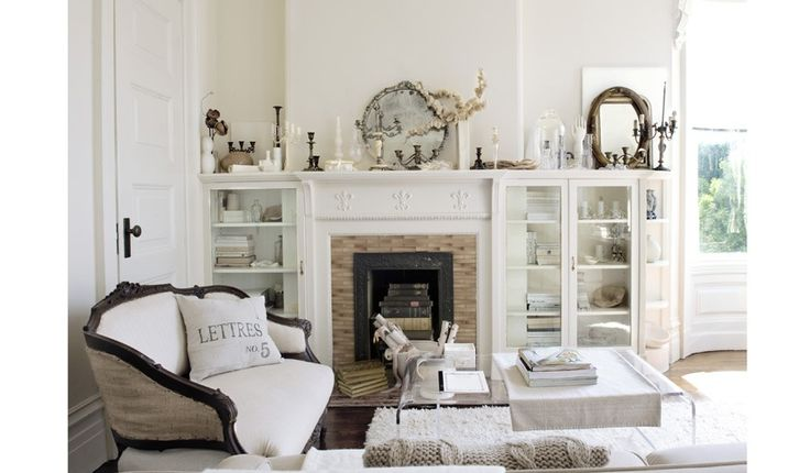 Oh, white cabinets, settee, french pillow, fireplace mantle... what is NOT to love about this room?