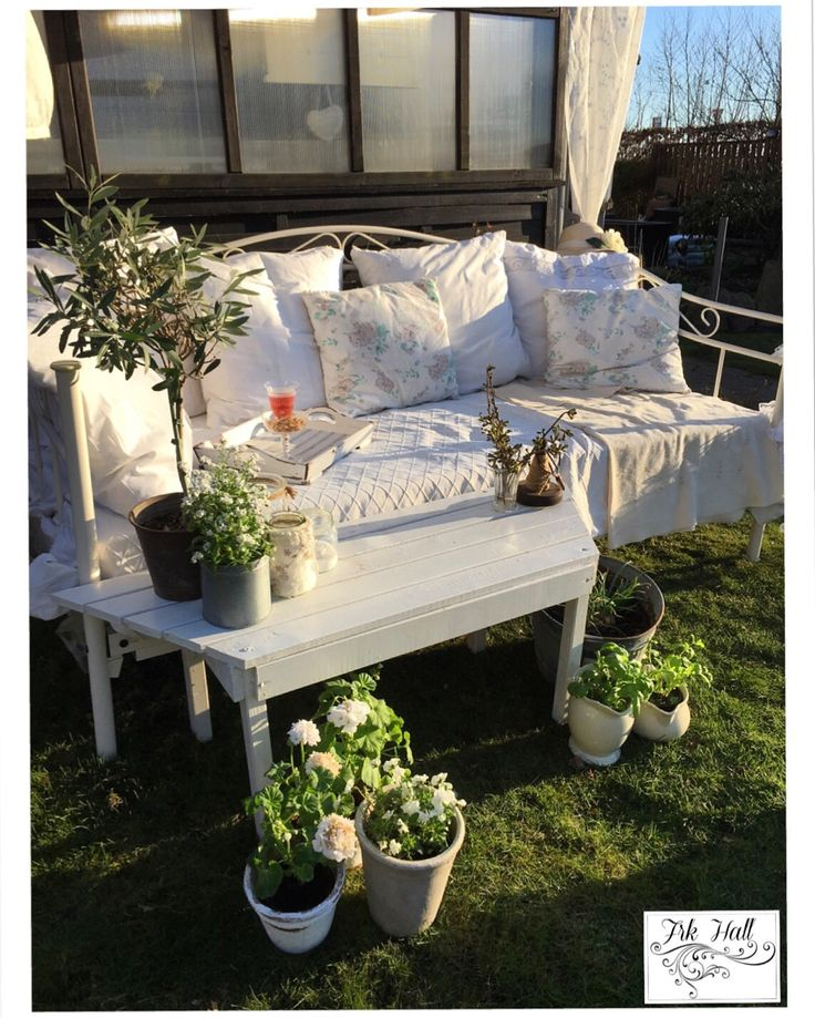A very romantic white shabby chic daybed in my beautiful garden