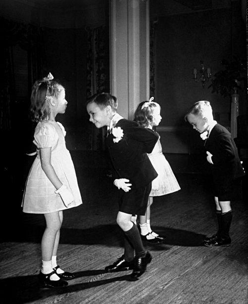 Alfred Eisenstaedt: Children in ballroom dancing glass 1945