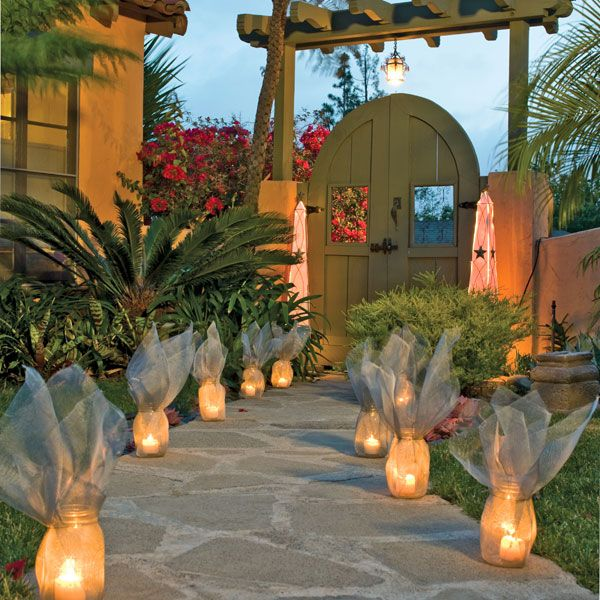 Screen-Wrapped Luminaries     Wrap economical canning jars in window screen fabric for luminaries that transform from airy sculptures during the day to warm, glowing lights at night.