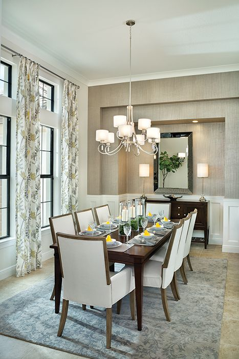 Light all around including the large windows give space to this elegant dining room.