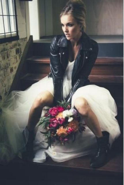 tulle wedding dress with a leather jacket anf boots