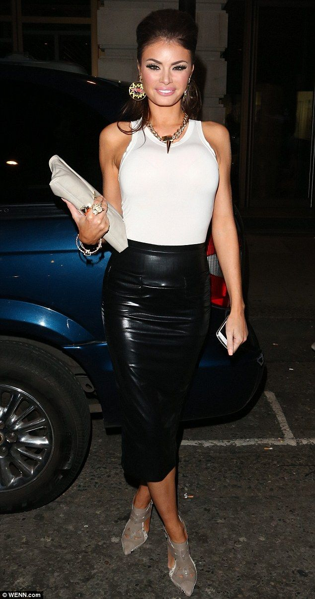 Super tight: Chloe Sims steps out in a fitted PVC pencil skirt on a night out in London