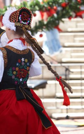 The back side glimpse of a beautifully embroidered traditional Polish folk costume