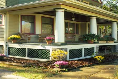 Porch lattice. This Old House Sprucing Up The Front Porch. Really practical--the lattice is hung on hinges, rather than permanently attached. This allows the lattice to be lifted up, providing access to underneath for repairs and for storage.