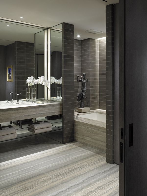 dark contemporary bathroom by gary lee love the tile on the floor