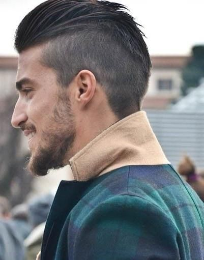 men hairstyle with shaved sides and back,