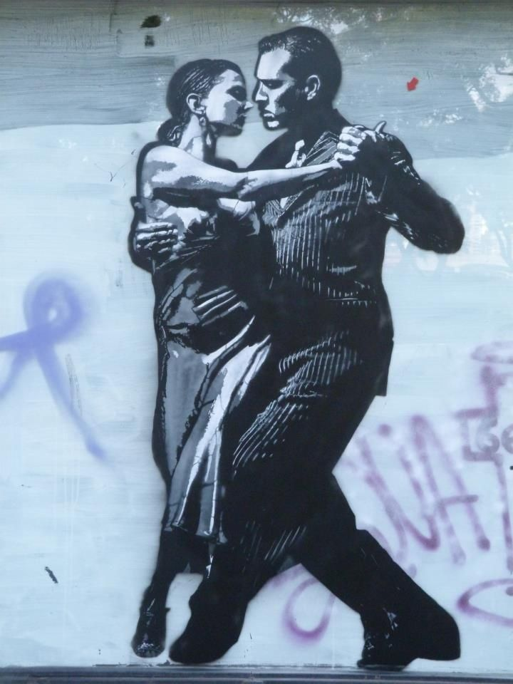 A Tango dancing couple give a musical lilt to the Buenos Aires scene. This tribute to a dance was created by Purple Blogger.
