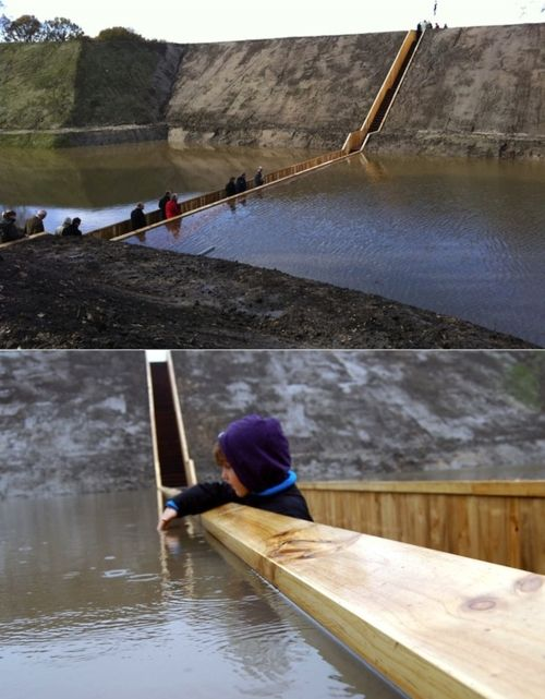 Moses Bridge, as its name suggests, is pedestrian bridge that creates the illusion of walking through water — in the West-Brabant waterline near Fort de Roovere in the Netherlands.Designed by RO & AD Architects.Water, Buckets Lists, Walks, The Netherlands, The Bridges, Places, Moi Bridges, Moses Bridges, Weights Loss