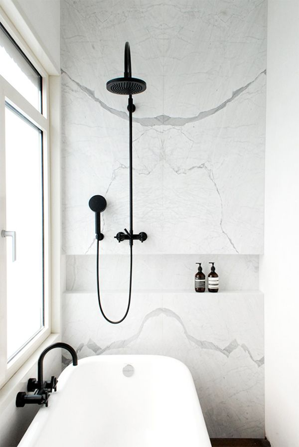 The veins on this master bath are out of this world. A very functional element- to keep clutter away is to build a niche on the wall. For more practical insights follow my boards. Visit my website: www.dmm-studio.com