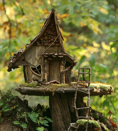 """afairyheart:  the-sky-is-calling:   Fairy House by Lana Gramlich      """"It is frightfully difficult to know much about the fairies, and almost  the only thing for certain is that there are fairies wherever there are  children.""""   ―J.M. Barrie, Peter Pan in Kensington Gardens"""