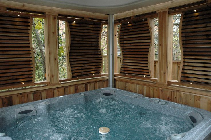 Enclosed hot tub area complete with lighting, privacy ...