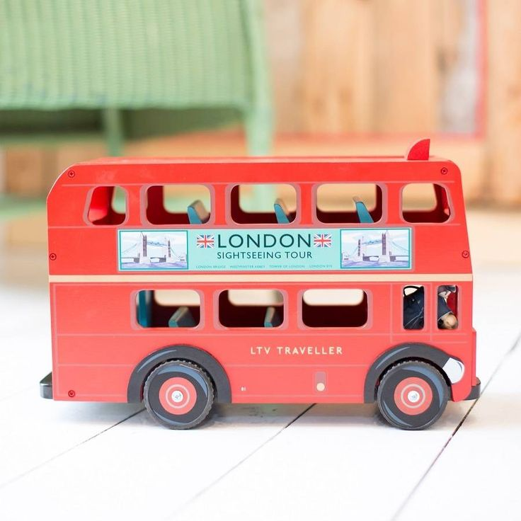 Personalised Wooden London Bus  This lovely red double decker London bus has a removable roof and room for 11 passengers. It has authentic London bus detailing and rubber wheels. Bus driver is included.  Perfect for any vehicle enthusiast for a Birthday or Christmas gift.