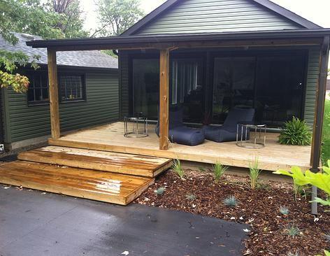 Wood deck, covered porch, meditation pad, beanbag chairs, hosta, grasses, mulch. Modern landscape design. Completed by Leaf Garden Design Inc.  | florence Ave