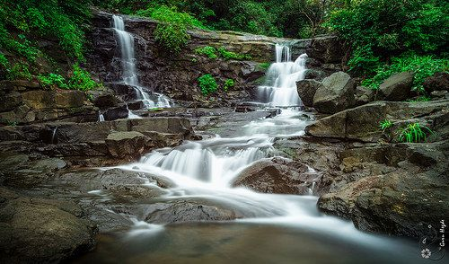Maharashtra Unplugged: A picturesque waterfall enroute Malshej Ghat, India. The Ghats of India are lovely with beautiful landscape, greenery and waterfall during the monsoon season