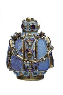 A gold, enamel and gem-set flask with screw top and chain. This richly decorated bottle was designed to contain perfume made from flower dis...