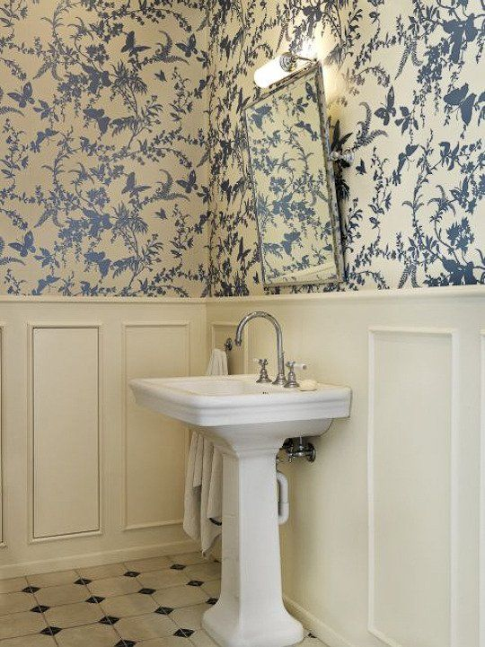 As classic as it gets; blue & white wallpaper with white painted wainscoting:  Tropical Floral by Florence Broadhurst