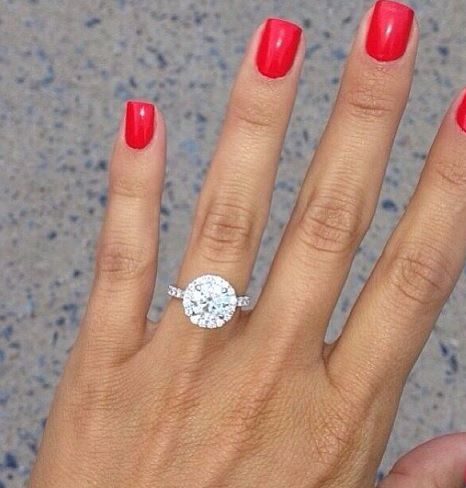 Round diamond halo engagement ring...look at that sparkle! I'm obsessed