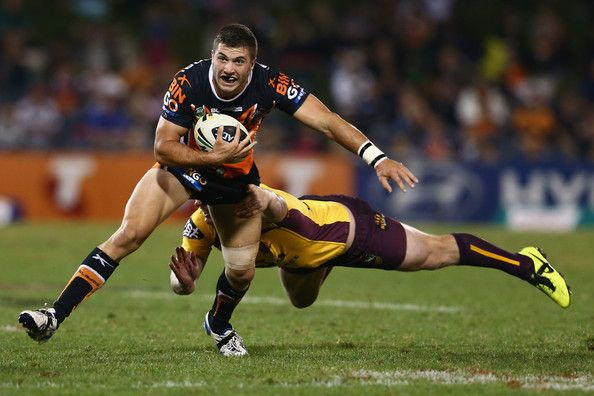 James Tedesco of the Tigers is tackled during the round seven #NRL match between the Wests Tigers and the Brisbane Broncos at Campbelltown Sports Stadium on April 27, 2013 in Sydney, Australia.