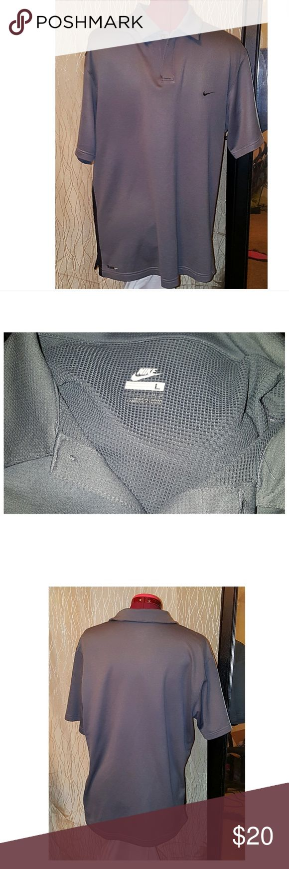 NIKE Polo Shirt NIKE Polo Shirt  EUC! Gray with black stripe running down each side, buttons all intact. Make an offer or hit buy now! Rock'N Ship is a Top 10% Seller on Poshmark and we add new items weekly. We are a Poshmark Ambassador, we buy and sell, shipping out almost daily. Please like or share our closet! Nike Shirts Casual Button Down Shirts
