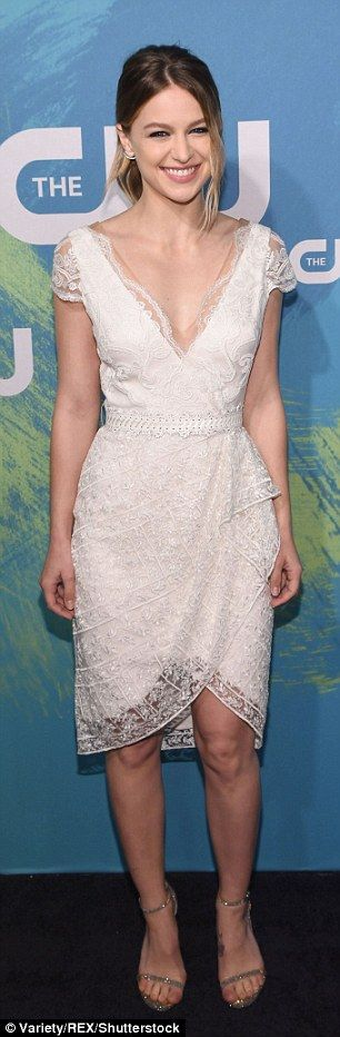 Pretty look: The 27-year-old beauty wore a delicate, lace dress with a V-neck front...