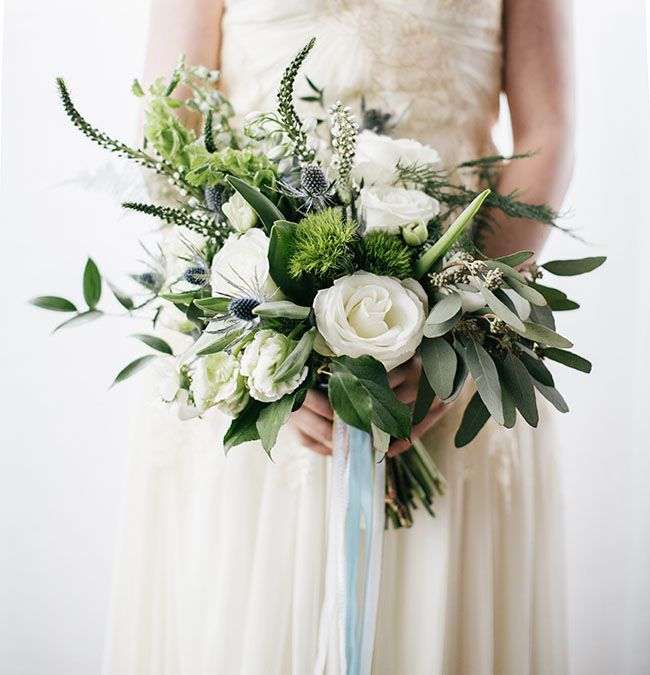 white and green bouquet with eucalyptus and thistle by Belovely Floral and Event Design