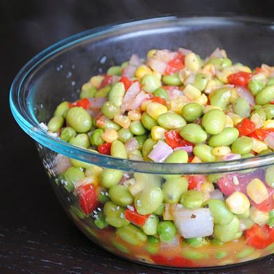 Edamame Succotash with edamame, corn, peas, onion, red bell pepper and dressing of garlic, olive oil, balsamic vinaigrette & salt.   Easy, economical, nutritious & fast!