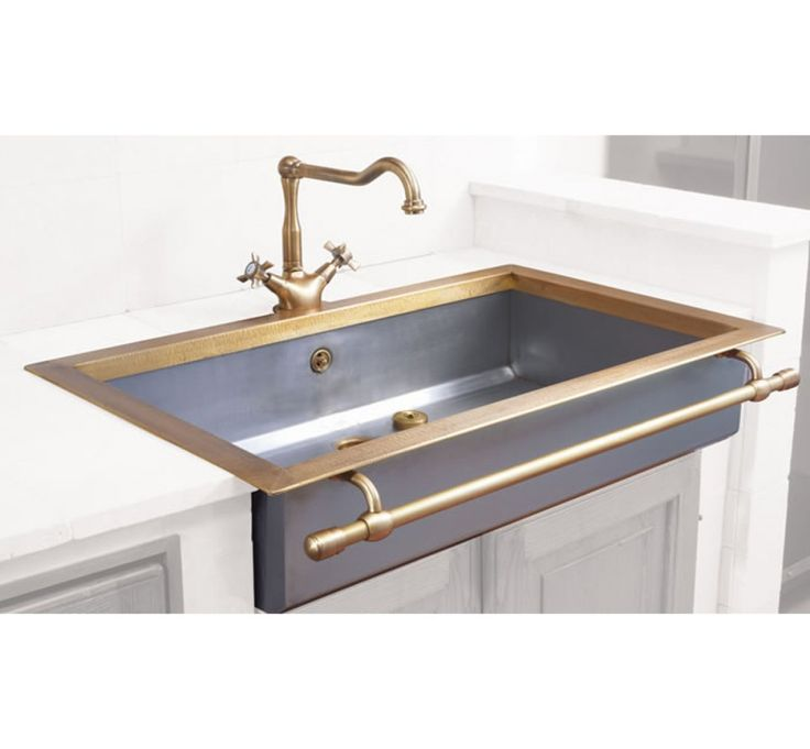Wow. Stunning kitchen sink with brass faucet & accents